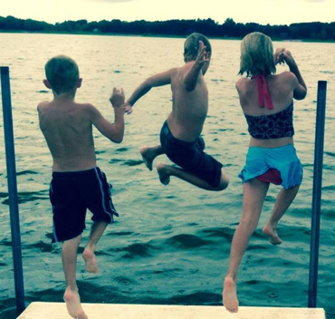 Children jumping from dock